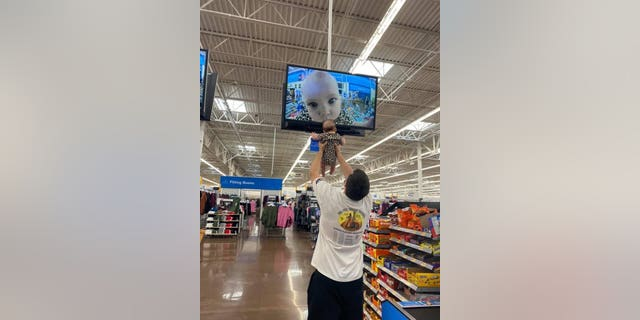 Nick and Kira Janzen stole the show at a Kansas-based Walmart this week, which is a moment that has gone viral. (Credit: Ivy Janzen)