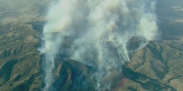 The Silverado Fire rapidly grew to 2,000 acres Monday in Orange County, Calif., driven by gusty winds.