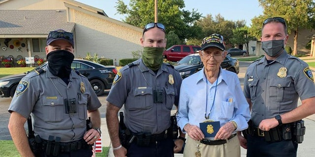 Oklahoma City police officers stopped to celebrate Raymond Duncan's 100th birthday on Monday.