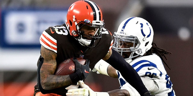 Cleveland Browns wide receiver Odell Beckham Jr. (13) rushes during the second half of an NFL football game against the Indianapolis Colts, Sunday, Oct. 11, 2020, in Cleveland. The Browns won 32-23. (AP Photo/David Richard)