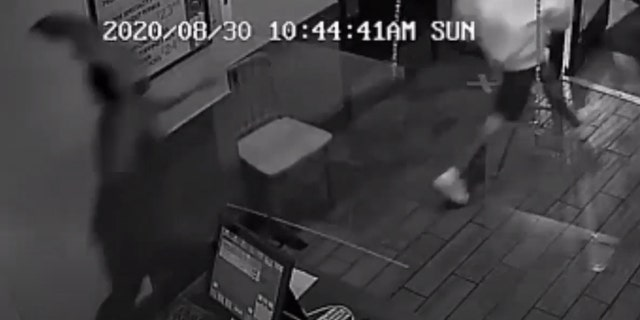 A worker at the Pizza Hut on Lockwood Avenue in Houston chases three men out of the store during an attempted robbery.