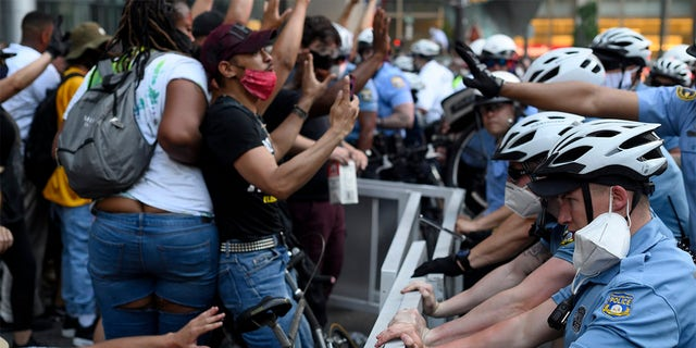 Police officers and protestors clash in Center City Philadelphia, PA on May 30.  (Photo by Bastiaan Slabbers/NurPhoto via Getty Images)