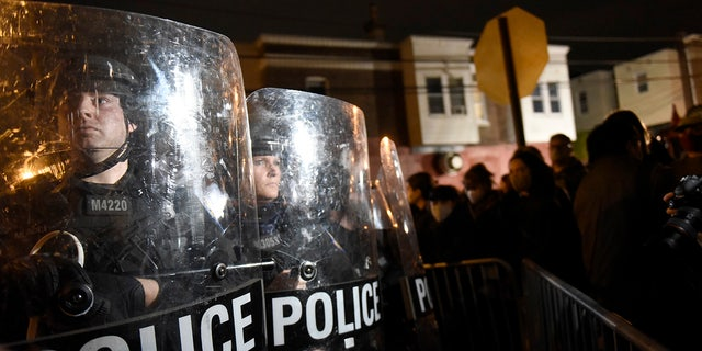 Philadelphia police officers form a line during a demonstration in Philadelphia, late Tuesday, Oct. 27, 2020. (AP Photo/Michael Perez)