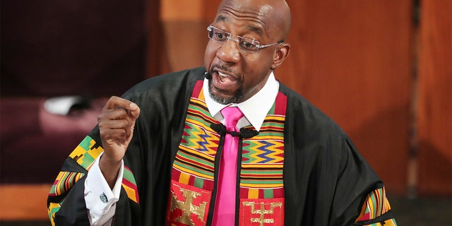 In this June 23, 2020, file photo, Rev. Raphael G. Warnock delivers the eulogy for Rayshard Brooks' funeral at Ebenezer Baptist Church in Atlanta. (Curtis Compton/Atlanta Journal-Constitution via AP, Pool)