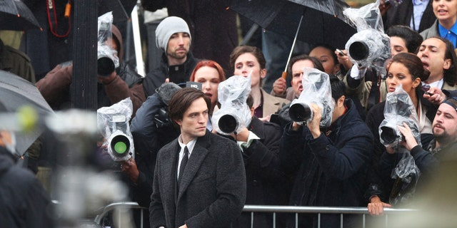Actor Robert Pattinson during filming of 'The Batman' outside St George's Hall in Liverpool, Monday Oct. 12, 2020. (Peter Byrne/PA via AP)