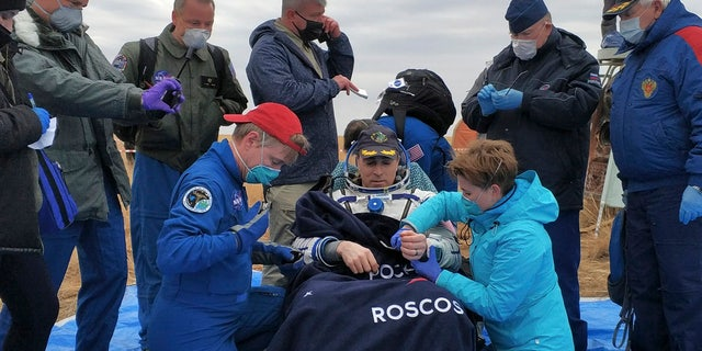 Space trio returns to Earth after six months