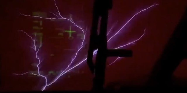 St. Elmo's fire can be seen outside a Royal Air Force C-17 aircraft near the equator.