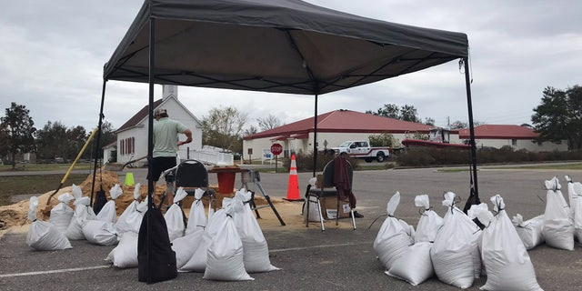 Officials in Orange Beach, Ala. were handing out sand and sand bags in preparation for Hurricane Delta.