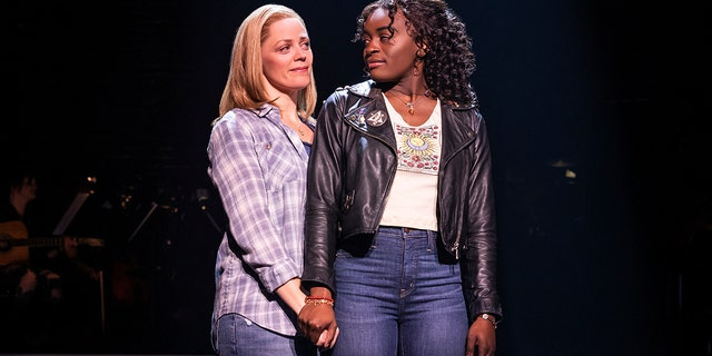 """This image released by Vivacity Media Group shows Elizabeth Stanley, left, and Celia Rose Gooding during a performance of """"Jagged Little Pill."""" The musical leads the Tony Awards nominations with 15 nods in a pandemic-shortened season."""