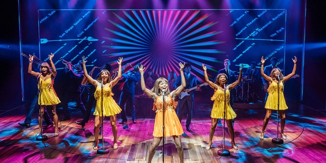 """This image released by Polk & Co. shows Adrienne Warren, center, during a performance of """"Tina: The Tina Turner Musical."""" Nominations for Tony Awards will be announced Thursday with just 18 eligible plays and musicals making the cut, a fraction of the 34 shows the season before."""