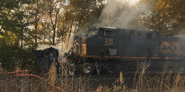 The aftermath after a freight train ran into a semi-truck that was stuck on the tracks in Pendleton, Ind. on October 9, 2020.
