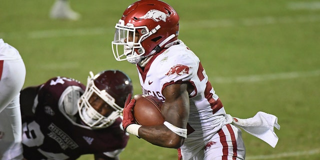 Arkansas running back Trelon Smith (22) carries the ball during the second half of the team's NCAA college football game against Mississippi State in Starkville, Miss., Saturday, Oct. 3, 2020. Arkansas won 21-14. (AP Photo/Thomas Graning)