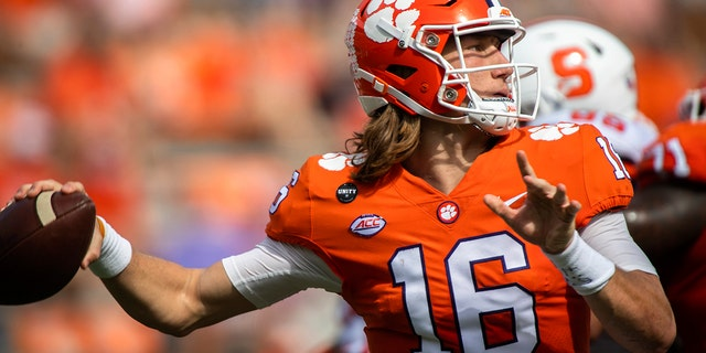 Clemson quarterback Trevor Lawrence (16) makes a pass during an NCAA college football game against Syracuse in Clemson, S.C., on Saturday, Oct. 24, 2020. (Ken Ruinard/Pool Photo via AP)
