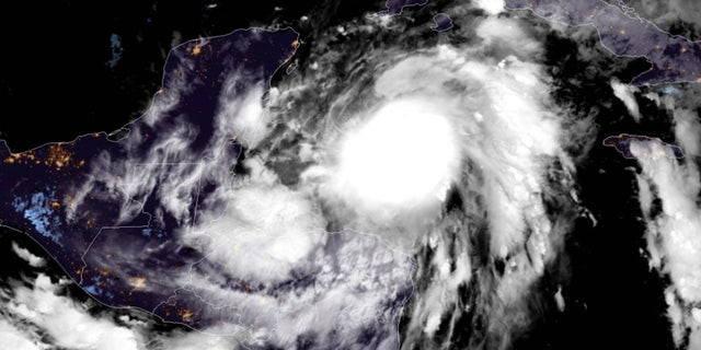 Tropical Storm Zeta is strengthening Monday as the storm approaches Mexico's Yucatan Peninsula.