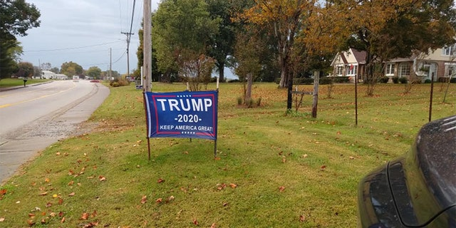 Powell said his other signs had been cut, but he sewed them back together and reinstalled them on his property.