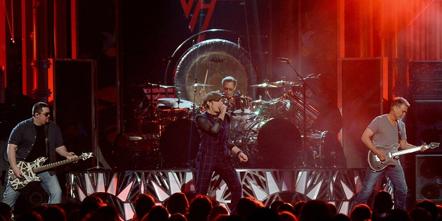Left to right: Wolfgang Van Halen, David Lee Roth, Alex Van Halen and Eddie Van Halen of Van Halen perform during the 2015 Billboard Music Awards at MGM Grand Garden Arena on May 17, 2015 in Las Vegas, Nevada. (Photo by Ethan Miller/Getty Images)