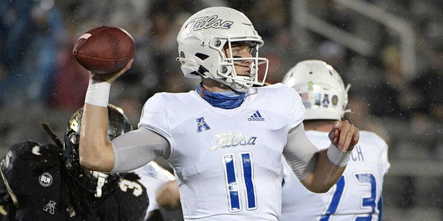 Tulsa quarterback Zach Smith (11) throws a pass in front of Central Florida defensive back Antwan Collier (3) during the first half of an NCAA college football game Saturday, Oct. 3, 2020, in Orlando, Fla. (AP Photo/Phelan M. Ebenhack)