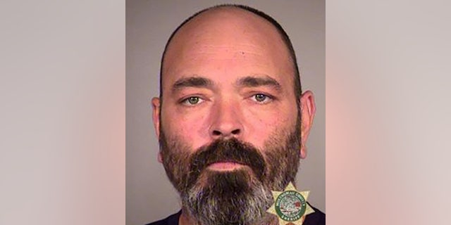 Alan James Swinney, 50, was indicted on various charges after allegedly pointing a revolver at a far-left demonstrator. (Multnomah County Jail)