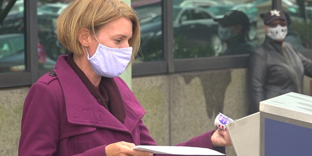 Amy Kennedy drops off her mail-in ballot in Atlantic City, N.J.