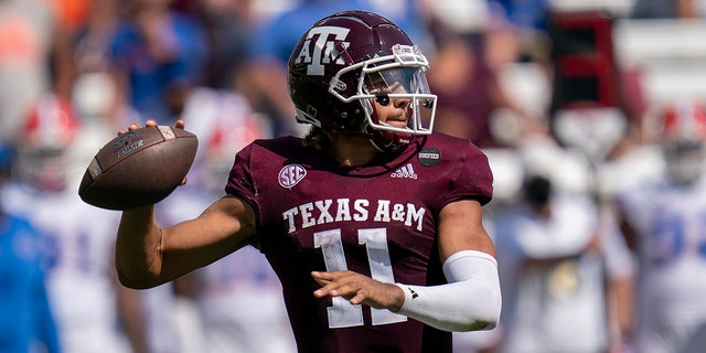 Texas A&M quarterback Kellen Mond (11) passes down field against Florida during the second half of an NCAA college football game, Saturday, Oct. 10, 2020. in College Station, Texas. (AP Photo/Sam Craft)