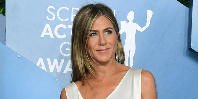 Jennifer Aniston is reminding fans to love themselves. (Photo by FREDERIC J. BROWN/AFP via Getty Images)