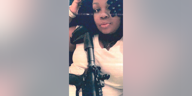 "A person identified as ""Breezy"" posing with AR-15 in a recently released photograph (Louisville Metro Police Department)"