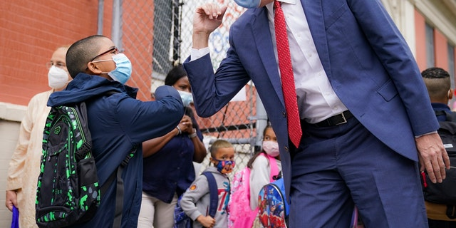 New York Mayor Bill de Blasio greets students as they arrive for in-person classes Tuesday in the Manhattan borough of New York City. (AP)