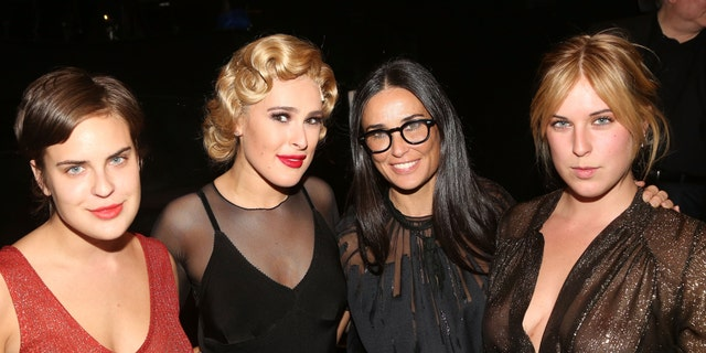Rumer Willis, second from left, appears with sister Talullah Willis, left, mother Demi Moore, center, and sister Scout Willis, right. (Photo by Bruce Glikas/FilmMagic)