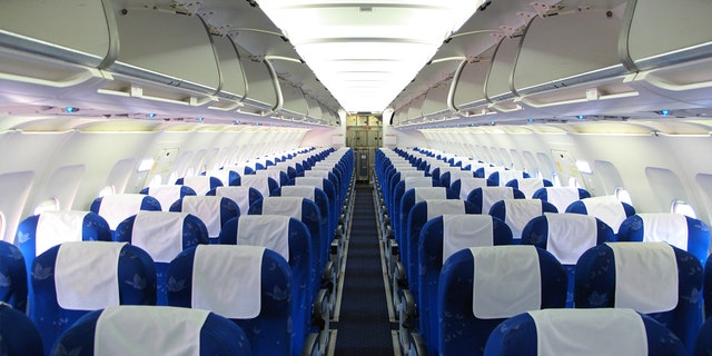 A Texas woman in her thirties died of the coronavirus during a commercial flight in July.