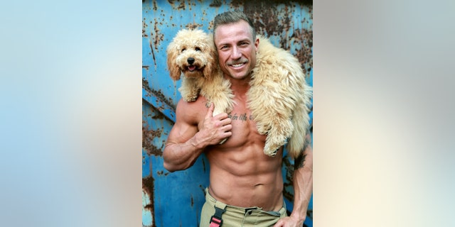 """Nathan and Leo the dog appear together in this year's """"Dog Calendar"""" edition."""
