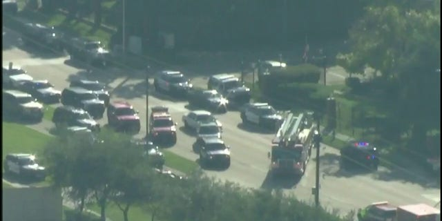 Police vehicles at the scene where two officers were shot in southwest Houston on Tuesday.