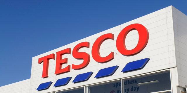 Edinburgh, Scotland, UK - 21st March 2011: Front entrance sign of a Tesco Superstore supermarket at the Hermiston Gait Retail Park in Edinburgh. Tesco divide their UK stores into six categories, with superstores such as this one being classed as a large supermarket.