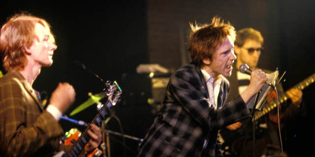 John Lydon performs with an early iteration of PiL (the band has had over 40 members through the years). (Virginia Turbett/Redferns)
