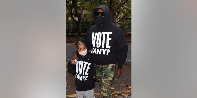 Kanye West and his daughter North rock 'Vote Kanye' gear while in London on Oct. 9. West will appear on ballots in states around the country in the 2020 presidential election. He announced his presidential bid on July 4.