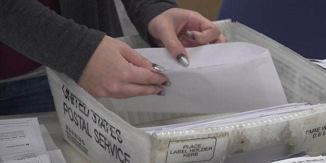 Election workers in Luzerne County - a swing county- are dealing with more mail-in ballots than ever.