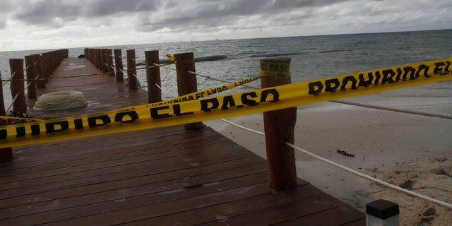 A dock is closed to the public before Hurricane Delta arrives near Playa del Carmen, Mexico, early Tuesday, Oct. 6, 2020.