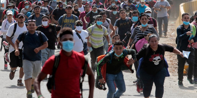 Migrants cross the border from Corinto, Honduras, into Corinto, Guatemala, on Thursday. (AP)