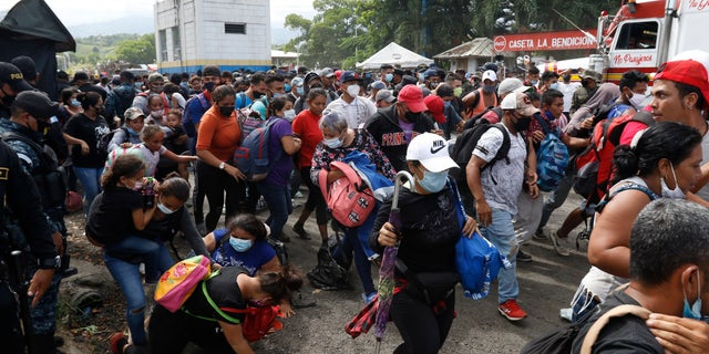 At the Honduras-Guatemala border, the migrants pushed past outnumbered Guatemalan police and soldiers who made little attempt to stop them. (AP)