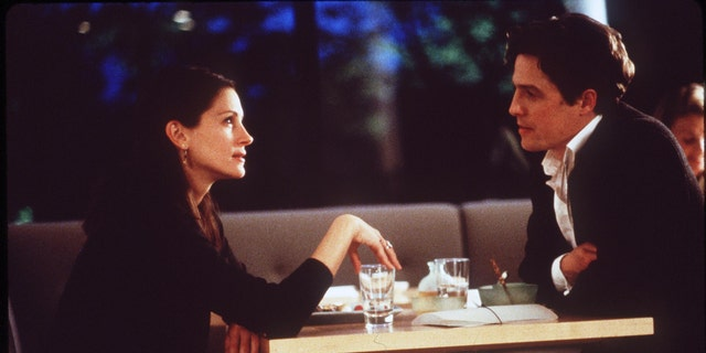 Julia Roberts (L) and Hugh Grant (R) in a scene from 'Notting Hill.' (Photo By Getty Images)