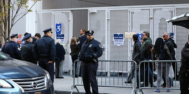 New York police take security measures as Republican presidential nominee Donald Trump arrives to vote at the Beckman Hill International School in New York City on Nov. 8, 2016. (Photo by Volkan Furuncu/Anadolu Agency/Getty Images)