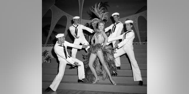In this May 20, 1957, file photo, actress Rhonda Fleming blossoms as a singer and dancer in the first night club appearance of her career at the New Tropicana hotel in Las Vegas.