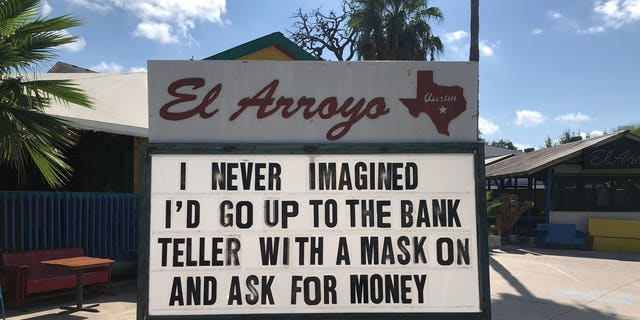 """""""I never imagined I'd go to the bank teller with a mask on and ask for money,"""" one sign teased."""