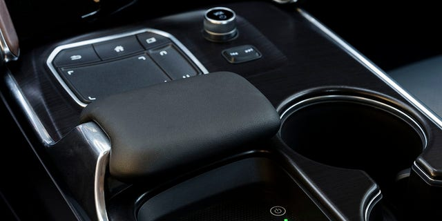 Acura's True Touchpad interface features a padded rest for your hand that's mounted ahead of a wireless smartphone charging pad.