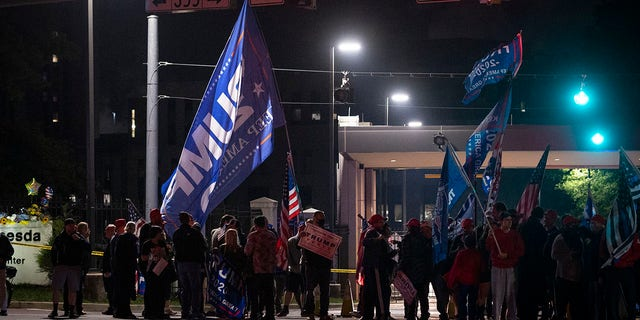 Supporters of President Donald Trump demonstrate at the entrance to Walter Reed National Military Medical Center in Bethesda, Md., Saturday, Oct. 3, 2020. Trump was admitted to the hospital after contracting the coronavirus. (AP Photo/Cliff Owen)