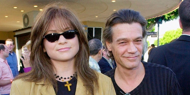 "Valerie Bertinelli, left, arrives at the premiere of the film ""America's Sweethearts"" with husband Eddie Van Halen in Los Angeles on July 17, 2001. (Associated Press)"