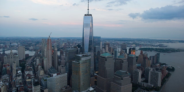 One World Trade Center stands the Lower Manhattan skyline at dusk in this aerial photograph taken above New York, U.S.  Photographer: Craig Warga/Bloomberg via Getty Images
