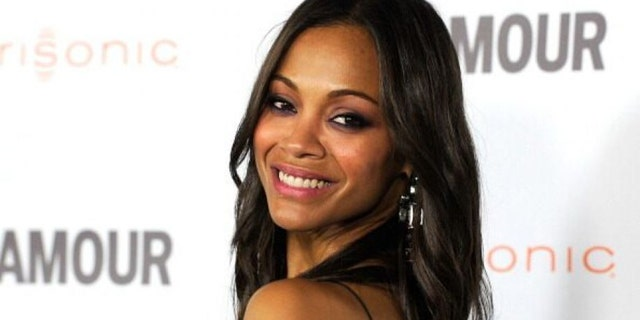 Zoe Saldana showed off her stunning figure in a pink bikini in honor of Breast Cancer Awareness Month.