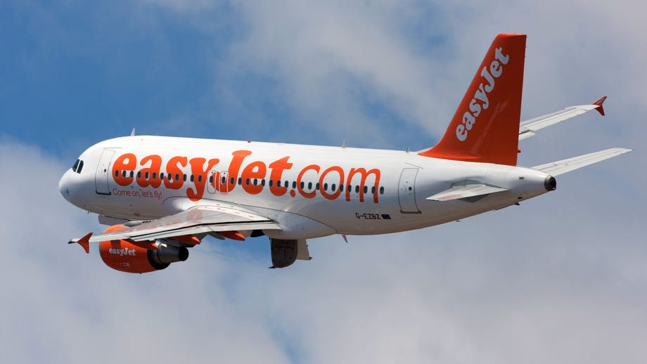 Easyjet passenger appears to intentionally cough on travelers as she's escorted from plane: 'Everybody dies'