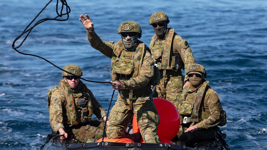 Australian Navy divers find unexploded bomb on reef, tow it to sea