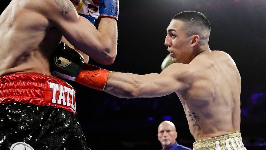 Teofimo Lopez upsets Vasiliy Lomachenko to unify lightweight titles